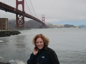 Ann at the base of the Golden Gate Bridge